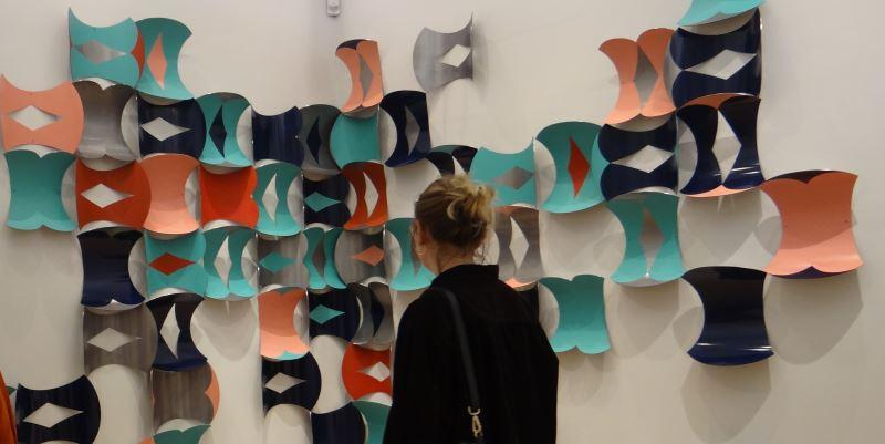 Woman looking at Lucy Davidson's Tessellations, 2017, copyright The Artist