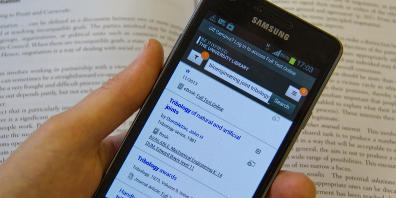 Search at library on mobile phone with book