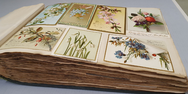 A photograph of a scrap book from the 19th century