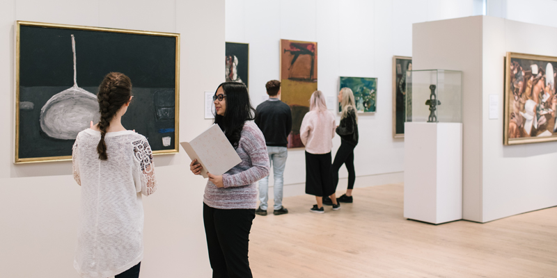 Visitors looking at artworks in the Gallery
