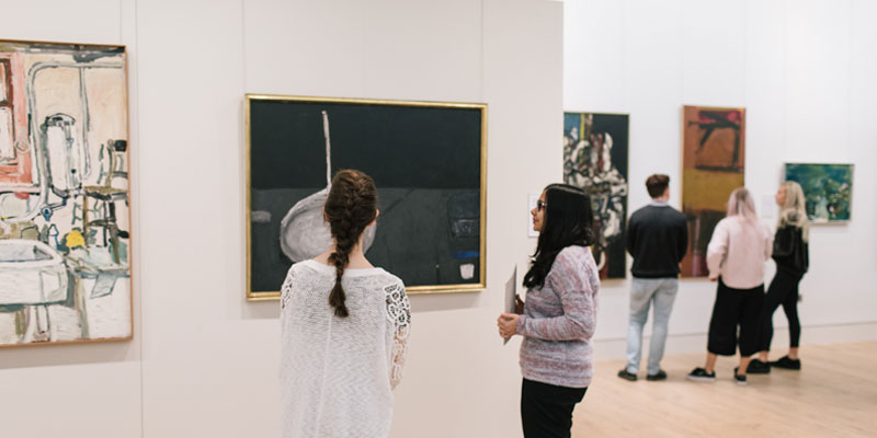 Visitors in the main space of the The Stanley & Audrey Burton Gallery