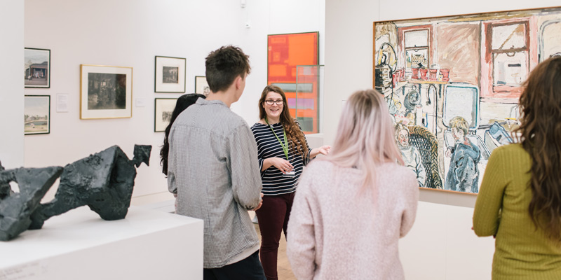 A talk given to visitors in front of artworks in the Gallery