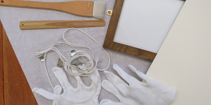 A close up view of white gloves and other conversation tools