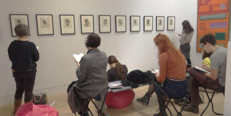People sat drawing in the art gallery at Sketch Club