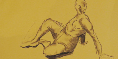 A life drawing sketch, of a man sat down with his legs stretched out