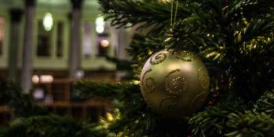 Close-up of a gold bauble on the Christmas tree with the Brotherton Library in the background