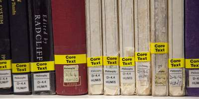 Close-up of some core texts on a Library shelf.