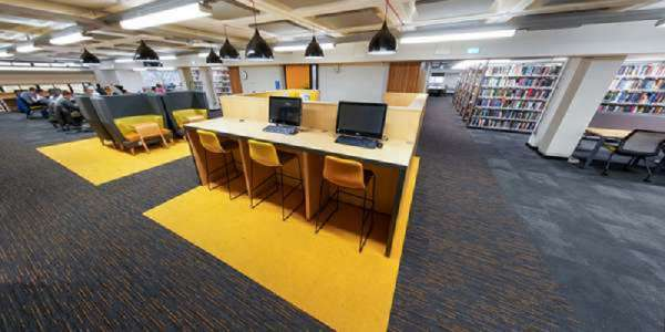 Desks with computers in the Edward Boyle Library