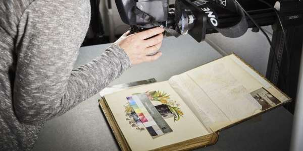 A book being photographed for digitisation