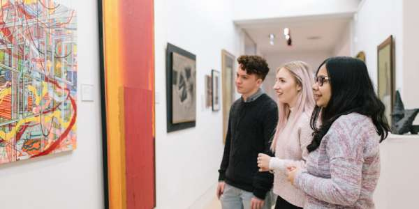 visitors looking at artwork in The Stanley and Audrey Burton Gallery